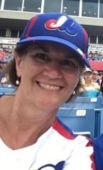 Arlene Smith wearing an Expos baseball cap
