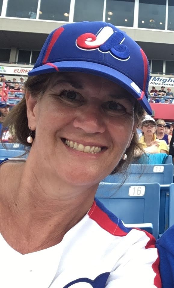 Arlene Smith wearing an Expos baseball cap