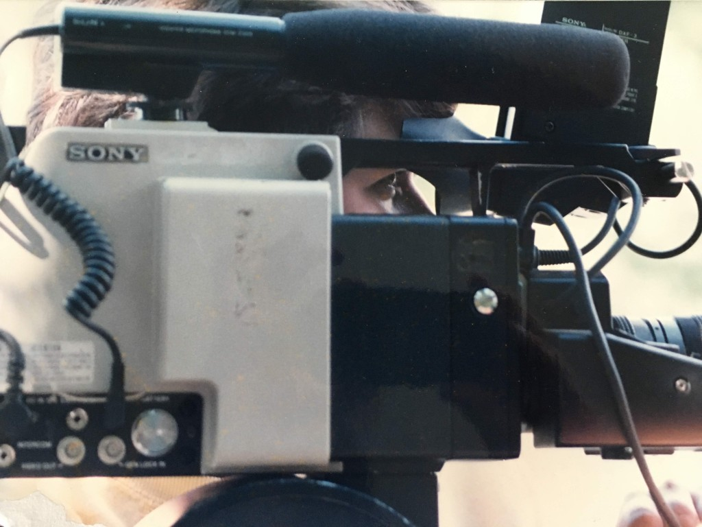 Sony video camera from the side with the shooter's eye visible