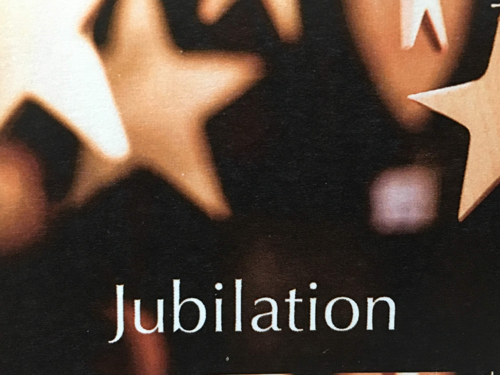 The word Jubliation on a starry background