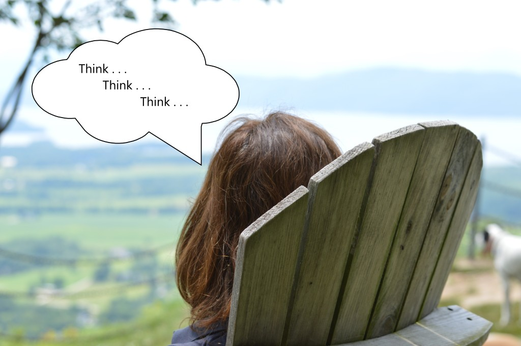 "Woman in a chair contemplating a mountain view. A thought bubble says, ""Think, think, think."""