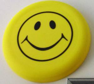 yellow frisbee with a happy face