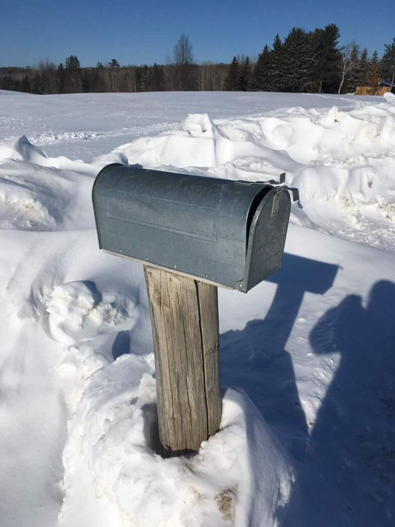 A country mailbox with no name written on it.