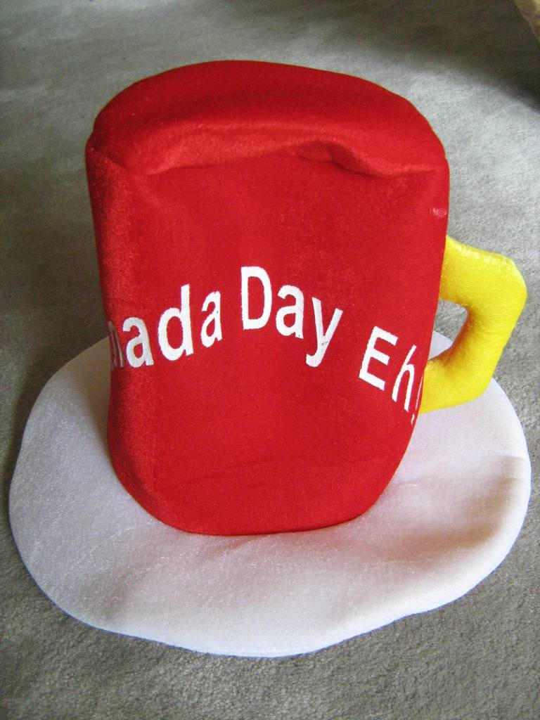 """Hat in the shape of an inverted beer mug with the words, """"Canada Day Eh!"""""""