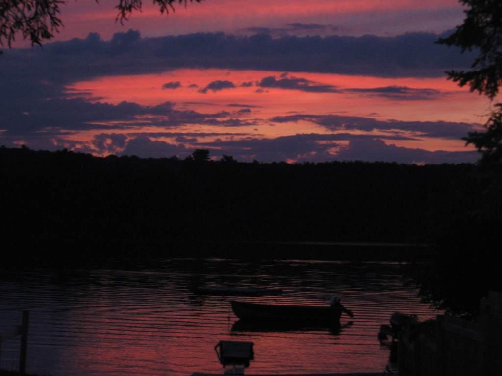 Orange and purple sunset over a lake
