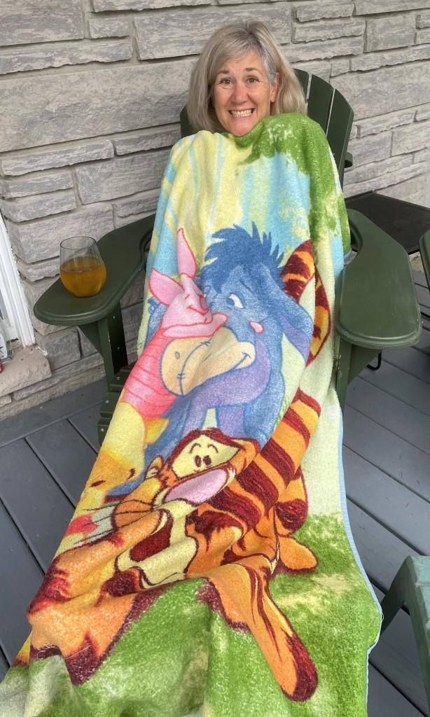 Arlene Smith on her front porch under a Winnie the Pooh blanket